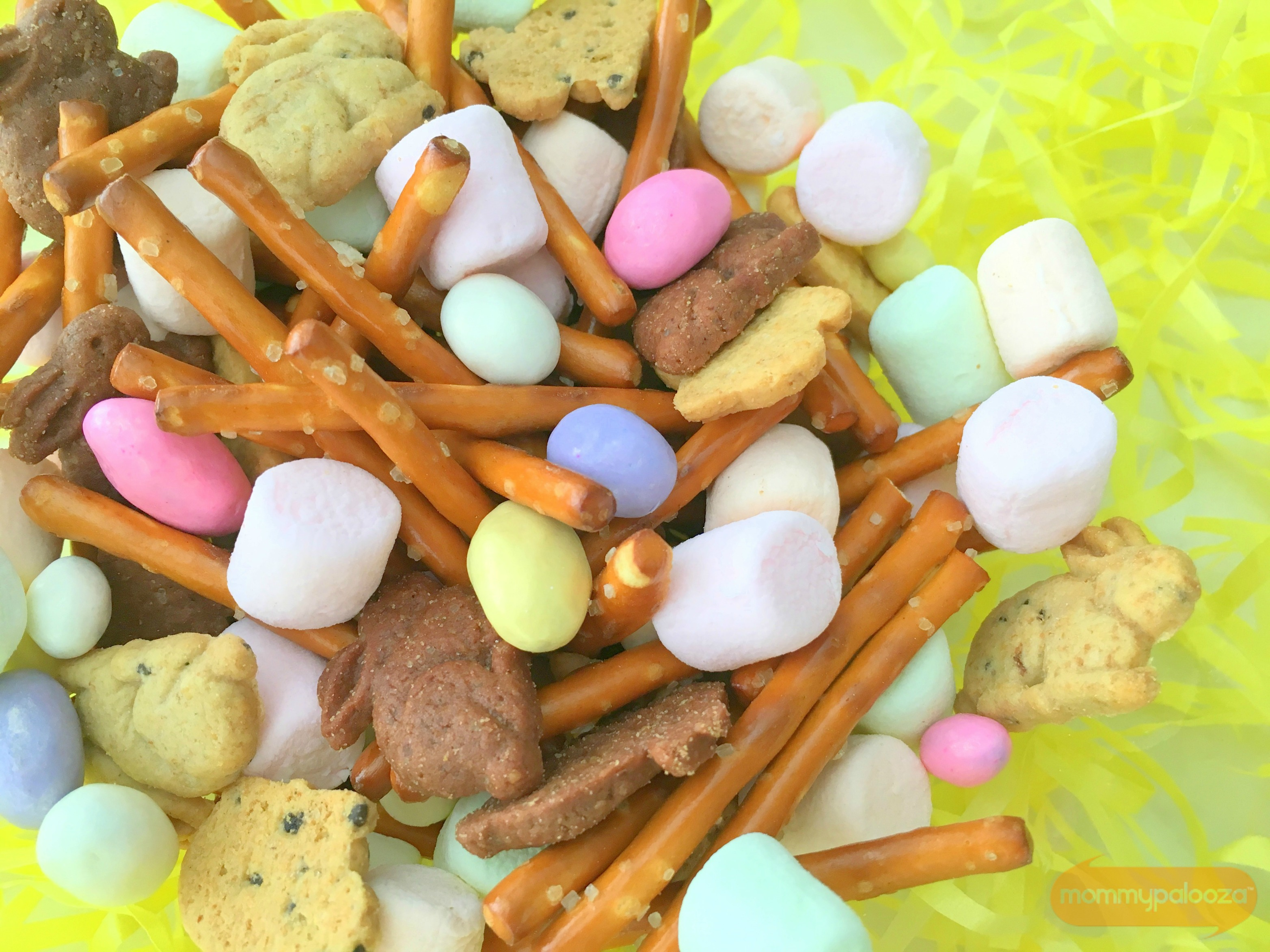 This is a fun and easy snack idea for kids that is Easter and spring themed. Sweet, salty, and tasty! The rainbow marshmallows make it extra special!