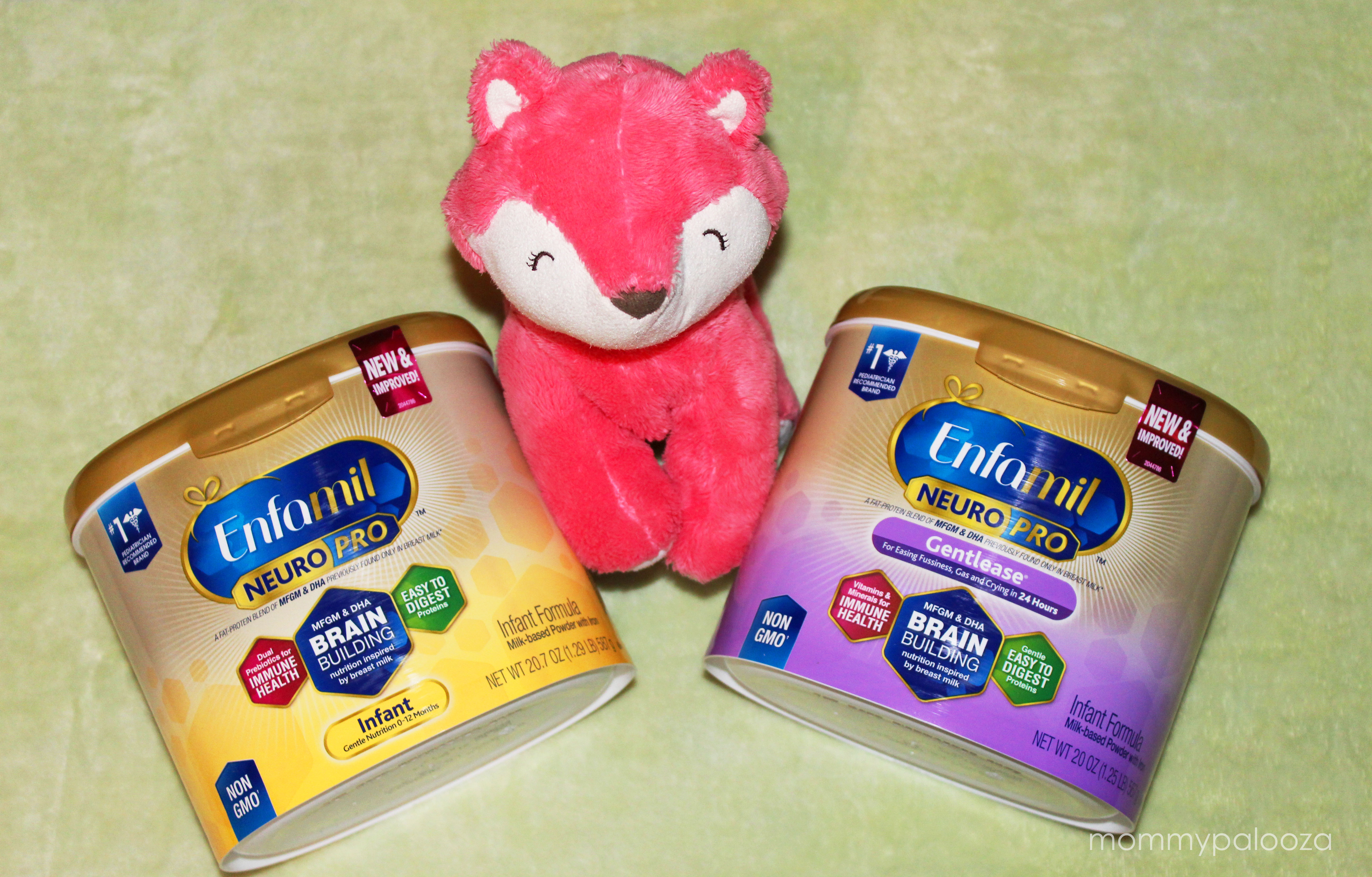 two containers of Enfamil NeuroPro next to pink stuffed fox animal toy