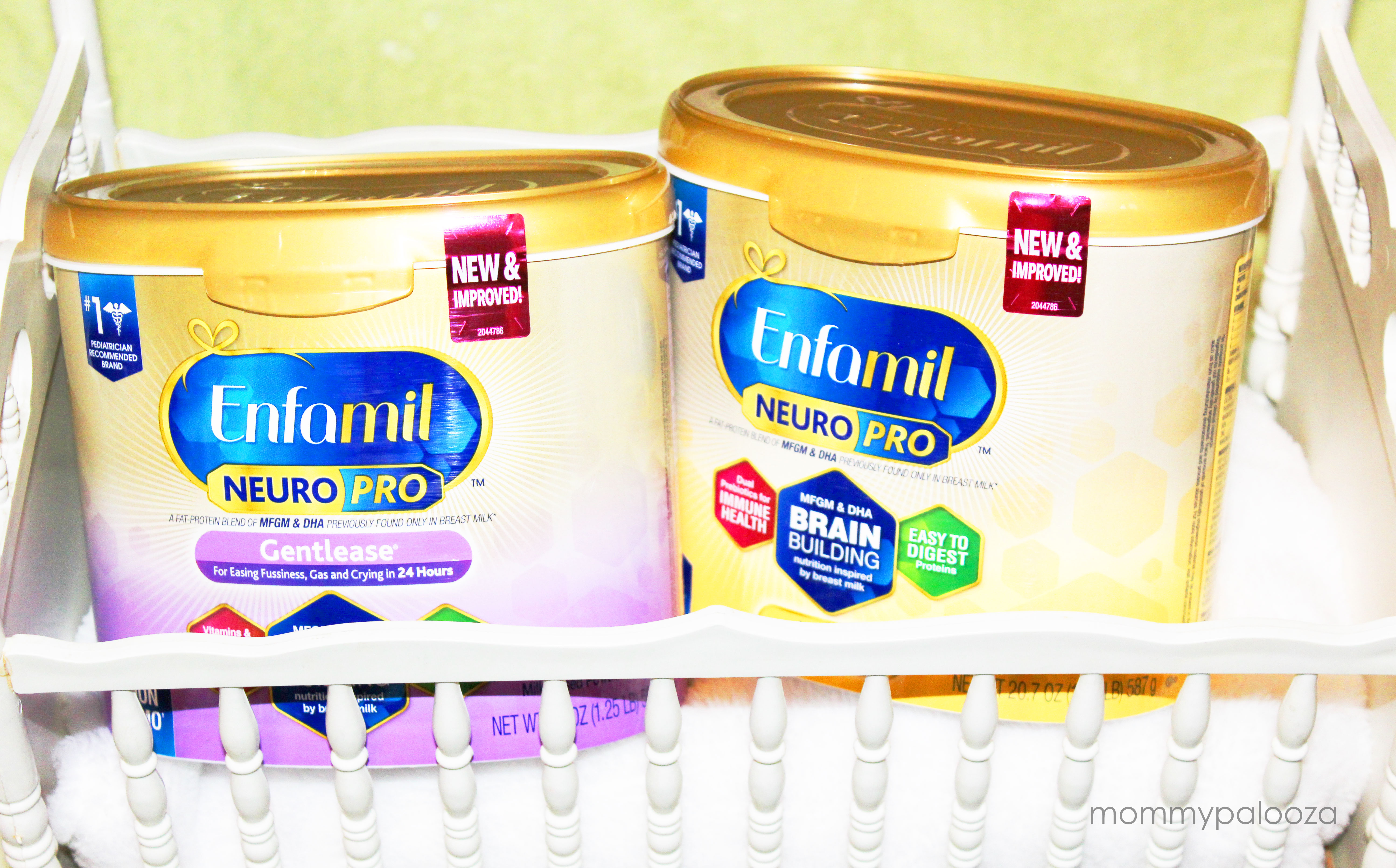 Enfamil NeuroPro in containers inside baby crib