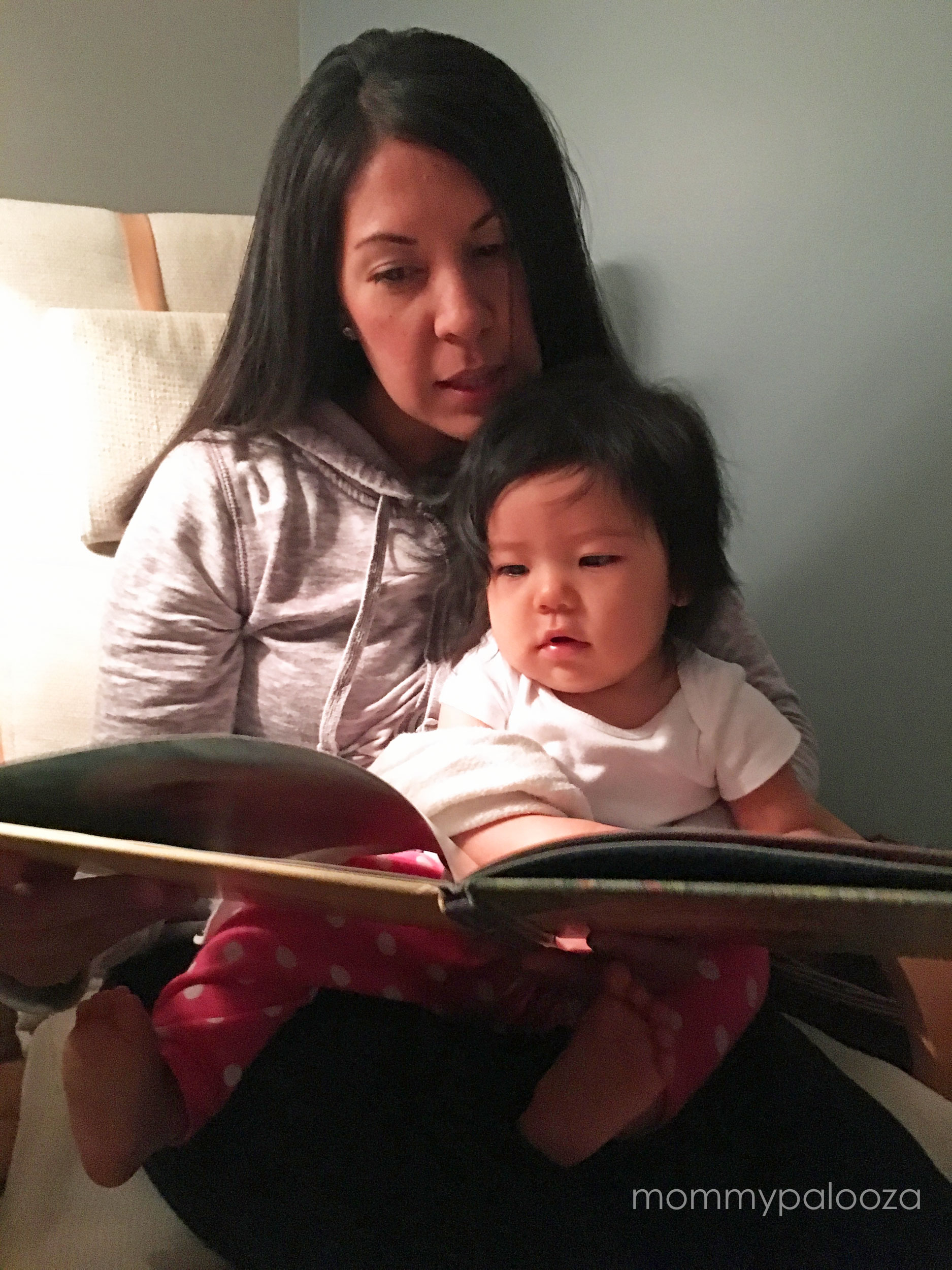 mommypalooza and baby reading a book