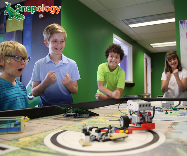 STEM learning and summer fun - kids interacting with robot